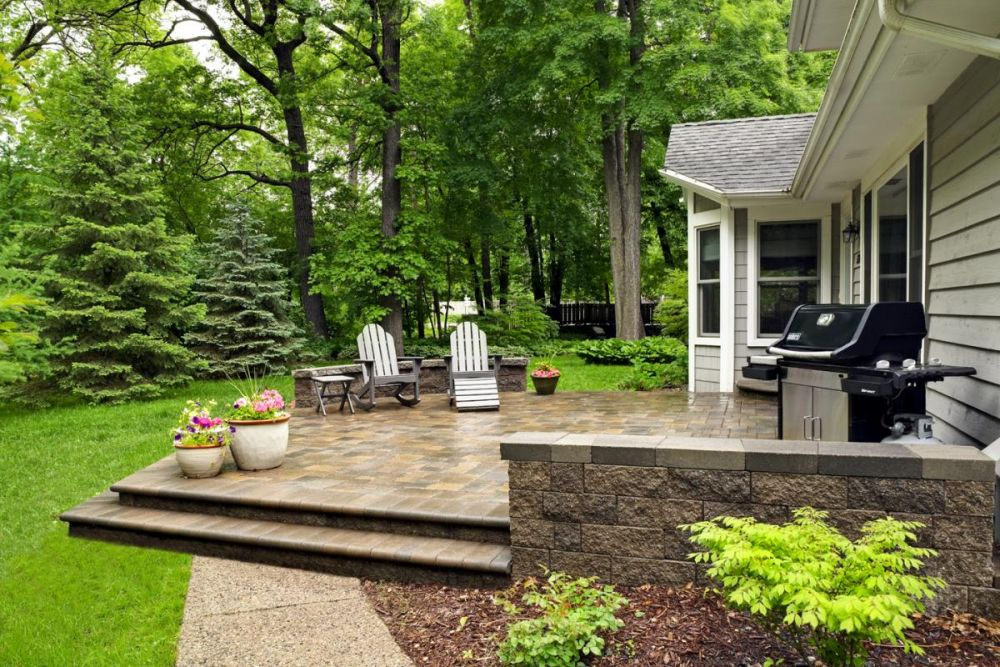 Aesthetic Paver Stone ... were used to create a platform for the paving stone patio as well as  two seat walls that add a measure of privacy, safety and aesthetics to the  patio.