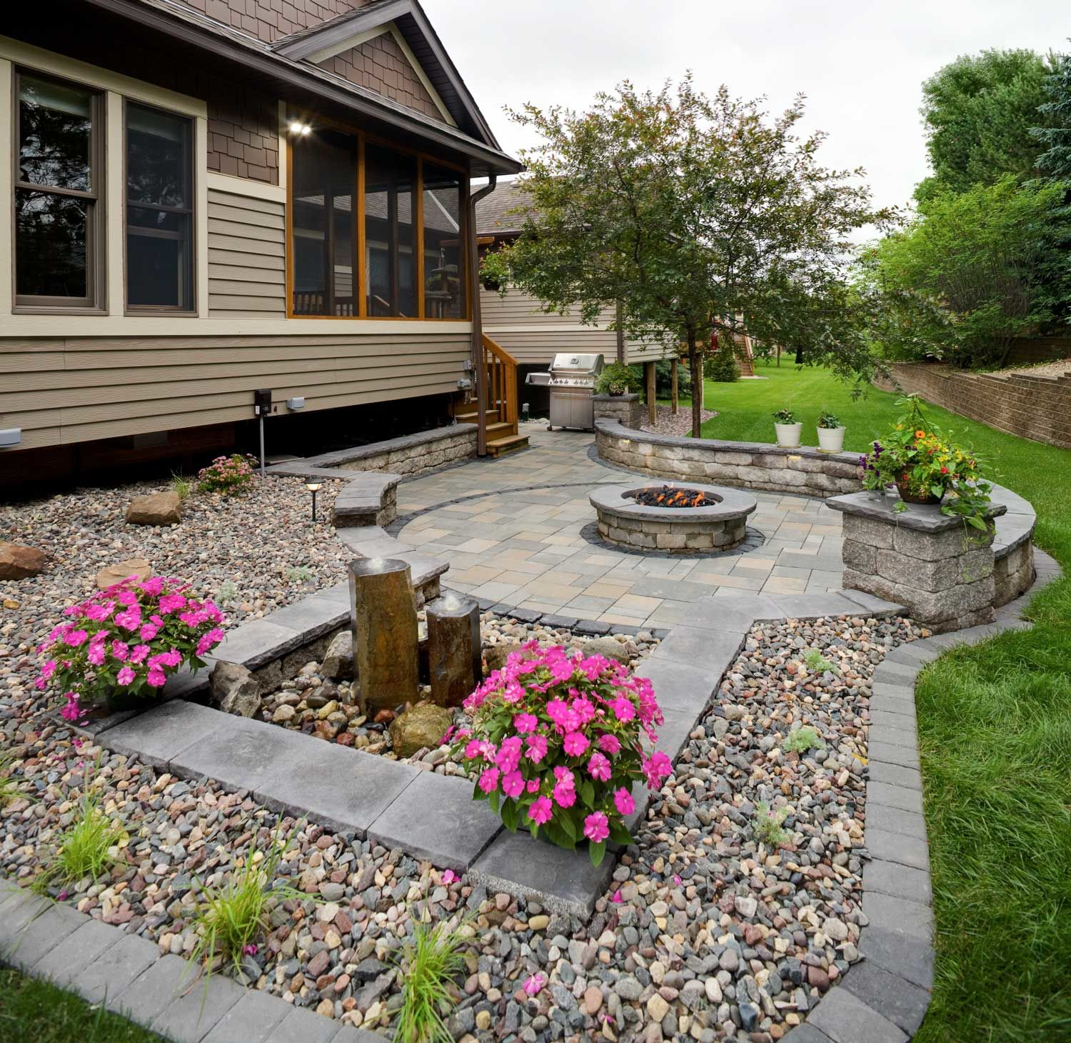 Sit back and relax on a beautiful, maintenance-free paver patio