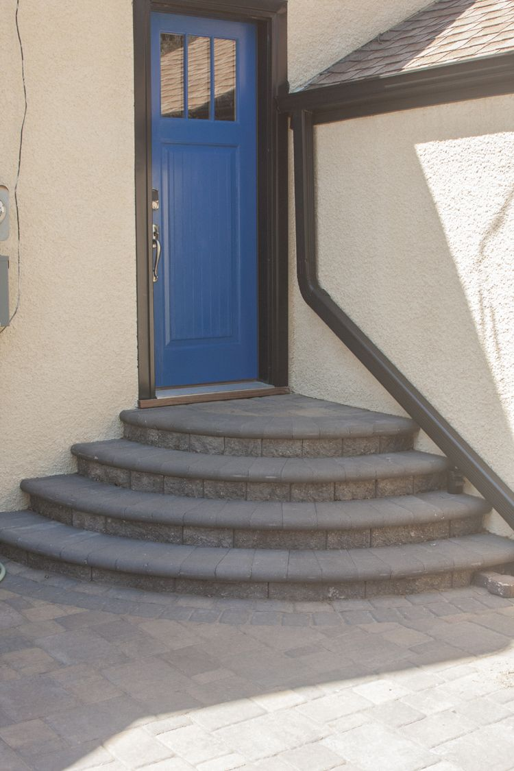 One-piece concrete steps were removed to create a VERSA-LOK pedestal stack staircase, making a stunning entrance to the back door of the home.