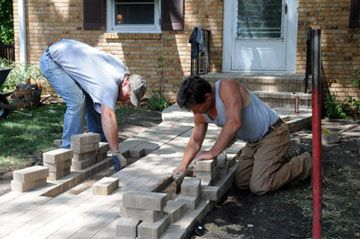 The final pavers were laid in place . . . .
