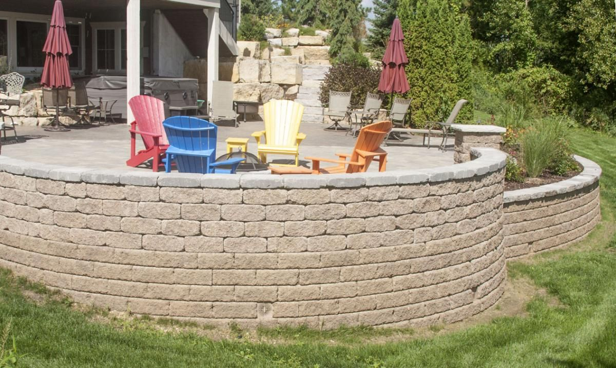 This stunning project designed by Villa Landscapes illustrates how hardscape products such as natural stone, retaining wall units and interlocking pavers combine artfully to create a backyard paradise.