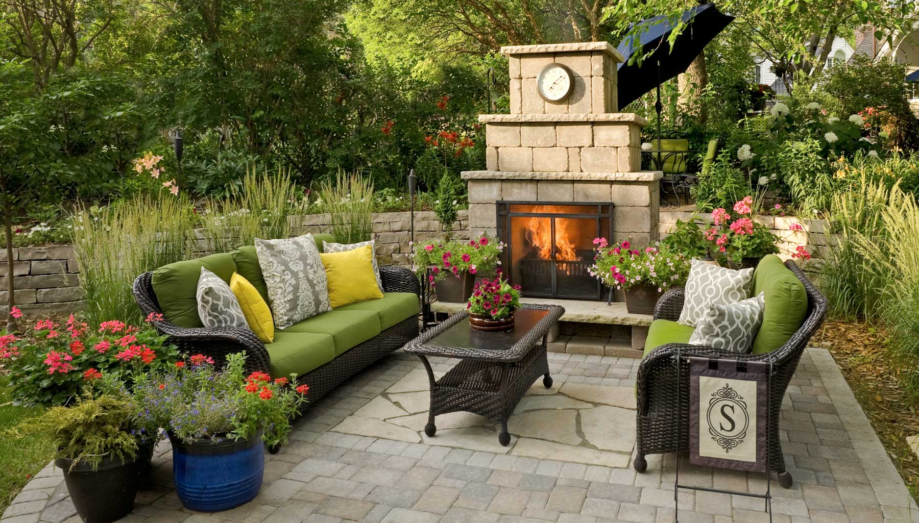 This beautiful and functional outdoor room is topped off with a grand fireplace.