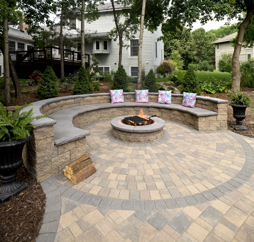 VERSA-LOK retaining wall blocks can create almost any outdoor living feature, including this couch surround a fire pit.