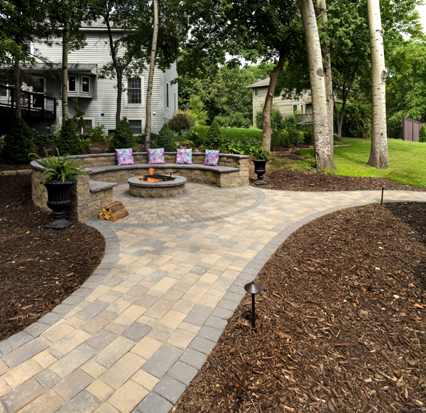 Enjoy the outdoors longer and later with a fire pit inset into a paver patio.