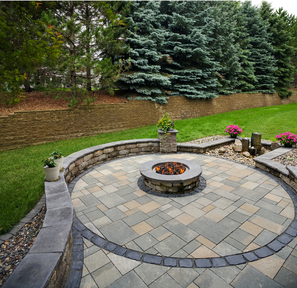 A backyard firepit is a great addition to any landscape design, especially in Minnesota.